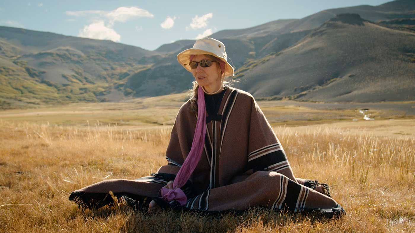 Cozy in her poncho, Ruth enjoys a solitary moment to meditate in the valley.