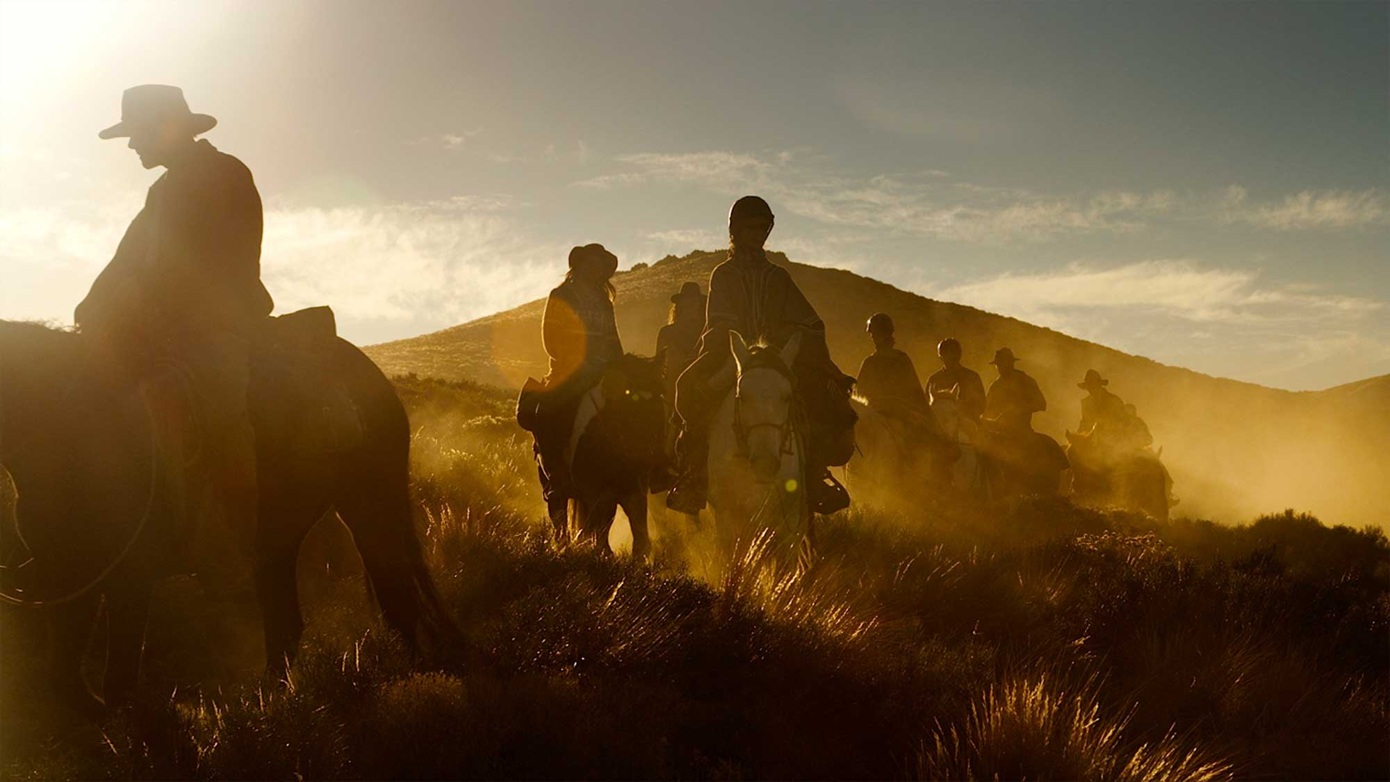 : The riders overcome dust swarms during their final miles homeward.